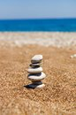 Cairn on the sand pile from stones beach near sea harmony and stability concept Stock Images