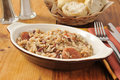 Cajun sausage bean and rice casserole a with dinner rolls Stock Photo