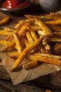 Cajun seasoned french fries with organic ketchup Stock Image