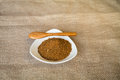 Cajun spice in a white plate and a wooden spoon Royalty Free Stock Images
