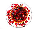 Cake berries on a glass platter Stock Photos