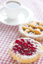 Cake with berries and tea on plaid fabric Royalty Free Stock Image