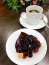 Cake blueberry with coffee cup in background cheese pie Stock Photo