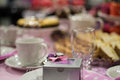Cake box with bow pink theme at dinning table Royalty Free Stock Images