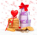 Cake and box gift with hearts background Stock Photo