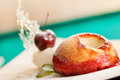 Cake with cherry on plate Royalty Free Stock Image