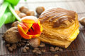 Cake with chocolate, coffee bean, tulip and nuts Royalty Free Stock Images