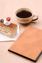 Cake with cup of coffee and book Royalty Free Stock Photo
