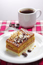 Cake and cup of coffee on a red tablecloth Royalty Free Stock Photography