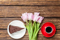 Cake and cup of coffee with tulips Royalty Free Stock Photo