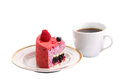 Cake with a cup of tea piece blueberry raspberry next Stock Photos