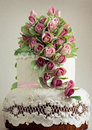 Cake delicious white wedding decorated with pink cream roses Stock Photo
