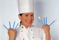 Cake design woman holding cook utensils pastry portrait Stock Images