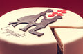 Cake for engaged white round on red background decorated with male and female silhouette of sugar on top Stock Photo