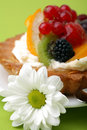 Cake with fresh fruits and flower Stock Photo