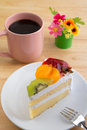 Cake with fruits and coffee cup a black Royalty Free Stock Images