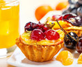 Cake fruits and juice sweet fruit cold on a table Stock Photo
