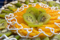 Cake with kiwi and orange slices delicious fruit white cream Royalty Free Stock Photography