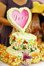 Cake with love heart closeup of decorative and fresh jasmine flowers Royalty Free Stock Images