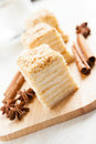 Cake Napoleon of puff pastry close-up and cinnamon Royalty Free Stock Photos