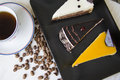 Cake pieces with various topping and coffee beans three of cheesecakes on plate closeup studio photo Royalty Free Stock Image