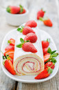 Cake roll with strawberries and cream cheese Royalty Free Stock Photo