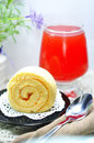 Cake roll sweet and fruit juice Stock Image
