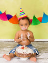 Cake smash baby boy adorable african during a on his first birthday Royalty Free Stock Photo