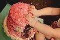 Cake smash little one enjoying a birthday Stock Photo