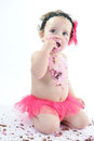 Cake smash shoot: Messy baby girl eating birthday cake! Royalty Free Stock Photo
