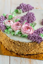 Cake with spring flowers close-up. Royalty Free Stock Photo