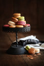 Cake stand with macaroons on dark wood background Stock Image