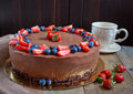 Cake Three chocolate with fresh berries and cup of tea Royalty Free Stock Photo