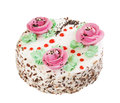 Cake with three decorative creamy roses on white Stock Photos