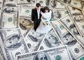 Cake topper couple bride and groom on money Stock Photo