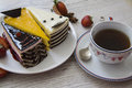 Cake with various toppings and cup of coffee three cakes slices topping fresh strawberry photo copy space Stock Image