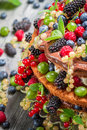 Cake wild fresh berry fruits closeup of Royalty Free Stock Image