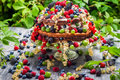Cake wild fresh berry fruits in forest on old wooden table Stock Photos