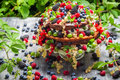 Cake wild fresh berry fruits on old wooden table Royalty Free Stock Photos