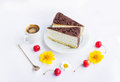 Cakes, coffee, cherries and flowers Royalty Free Stock Photo