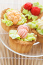 Cakes decorated four with raspberries Royalty Free Stock Image