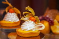 Cakes with meringue and berries of cape gooseberry Royalty Free Stock Photo