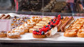 Cakes and pastries at local gourmet market stall. Royalty Free Stock Photo