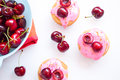 Cakes with pink cherry toping