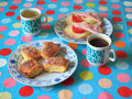 Cakes and sandwich plates with sandwiches mugs of tea as a symbol of breakfast Royalty Free Stock Photo