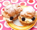 Cakes some with cream and blueberries Royalty Free Stock Image
