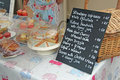 Cakes stall and price list this photo shows for sale Royalty Free Stock Photos