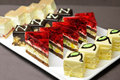 Cakes and sweets colorful on the plate Royalty Free Stock Photos