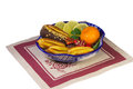 Cakes sweets fruit in a vase painted in the style of the filled with fruits blue pattern gzhel and presents on white background Stock Photos