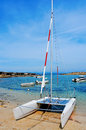 Cala sa roqueta cove in formentera balearic islands spain a sailboat and the mediterranean sea and the typical slipways and Royalty Free Stock Images